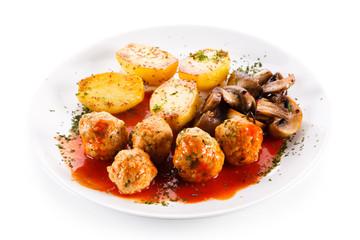 Roast meatballs with potatoes
