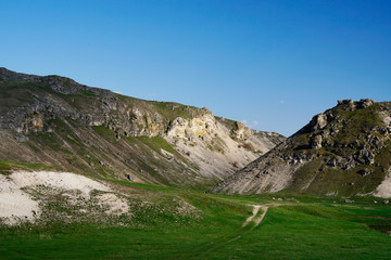 Path looping through rocky hills in Moldova