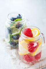 Lemon lime berries fresh infused water detox drink cocktail lemonade