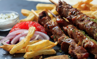 Grilled meat skewers and side dish