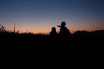 young couple  silhouette mountain
