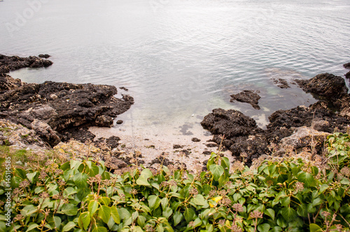 Fantastic landscape with calm and clear sea rocks and for Landscaping rocks new plymouth