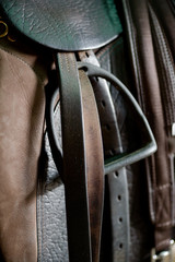 Close up of stirrup and saddle