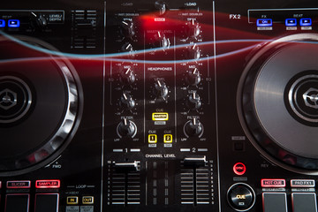 DJ Music night club, DJ technique - CD players and DJ console during the party.