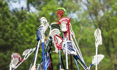 Lacrosse sticks held up together in team spirit
