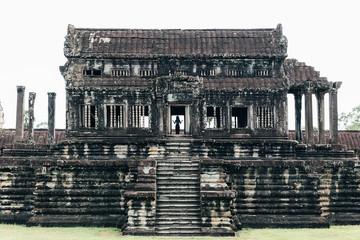 Silhouette of beautiful woman in Angkor Wat Temple.