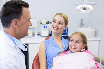 Dentist interacting with young patient