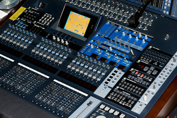 Close up of a sound board audio equipment