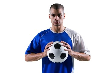 Portrait of football player holding football with both hands