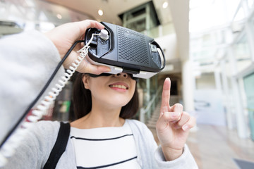 Woman using VR device