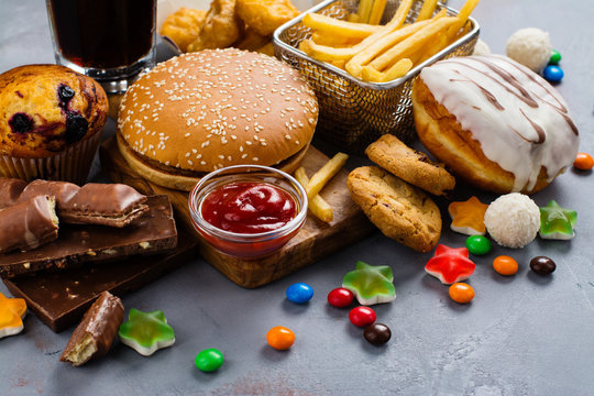 Assortment of unhealthy products that's bad for figure, skin, heart and teeth. Fast carbohydrates food. Space for text