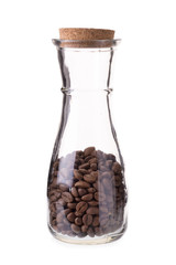 Coffee beans in glass bottles isolated on a white background