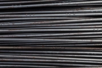 close up steel bar or steel reinforcement bar in the construction site, steel rods bars can use for reinforce concrete. construction background and texture.