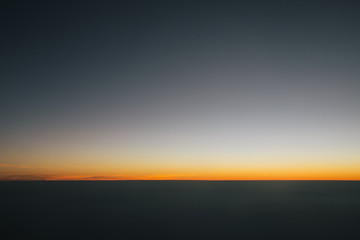 Sunset horizon line. Stratosphere sky background without sun. Wall mural