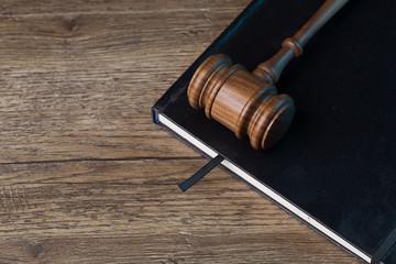 Judge's hammer on black folder