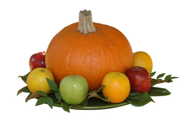 Fall Thanksgiving pumpkin and fresh fruit arrangement isolated on white