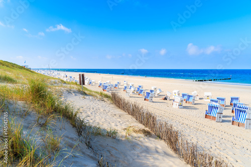 Fototapete View of beautiful beach with chairs in Wenningstedt, Sylt island, Germany