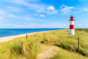 Fototapete - Ellenbogen lighthouse on sand dune and beach view on northern coast of Sylt island, Germany