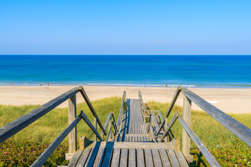 Fototapete - Wooden steps from sand dune to beautiful Westeland beach, Sylt island, Germany