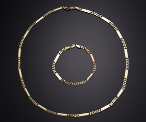 Golden necklace with isolated on black