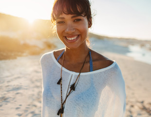 Portrait of young smiling woman on beach