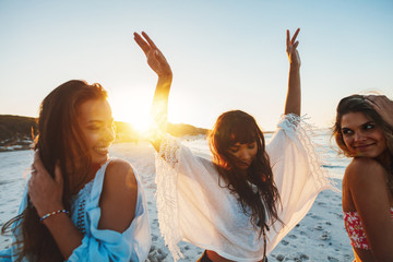 Three young woman having fun on beach