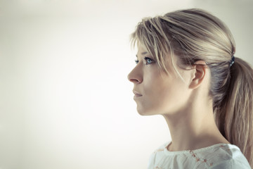 Profile of a beautiful serious blond woman