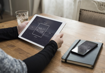 User with Tablet and Smartphone on Desk Mockup 2