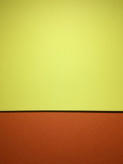 Two colors tone textured papers abstract background with copy space. Yellow and orange version. Rule of thirds used.