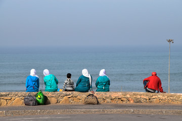 Muslim women with Hijab in the beach