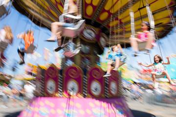 Children on carousel at fairground