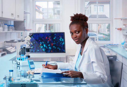 Female African scientist works in modern biological laboratory