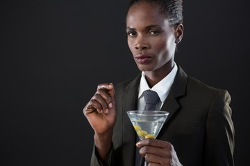 Androgynous man holding a martini glass