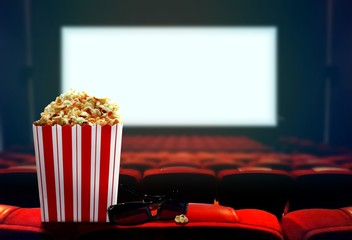 Cinema seat with popcorn and 3d glasses