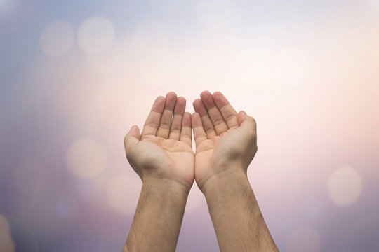 Human's hands pray on blurred nature background : helping hand concept.hand of god giving the power to human's hand., soft focused