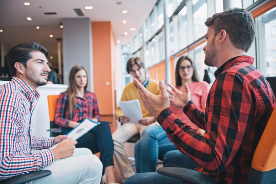 Shot of a group of young business professionals having a meeting.