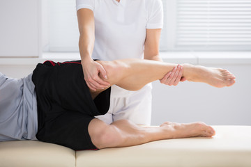 Close-up Of Physiotherapist Giving Exercise