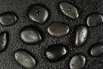 Black stones with water drops