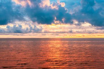 Bright golden sunset on the blue sea