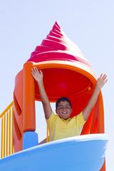 Boy Is Sliding Down The Slide