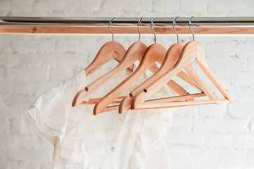 Clothes hang on clothing rack