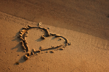 Heart drawing in the sand