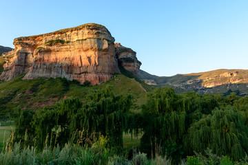 South Africa Drakensberge Golden Gate national park landscape,  scenic panoramic color landscape picture taken on a sunny day - impressive nature with rock landmark, blue sky,tress
