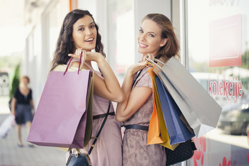 Two Smiling Women Shopping Together