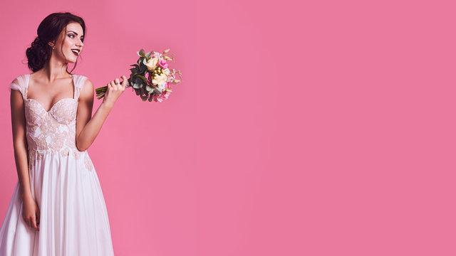 Brunet bride portrait in pink studio