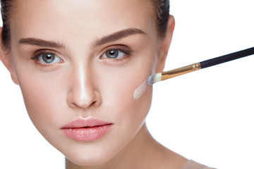 Woman Beauty Face Makeup. Female Applying Foundation