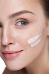 Facial Makeup. Skin Cream On Beautiful Sexy Woman Face
