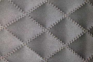 rough leather stitched thread diagonally