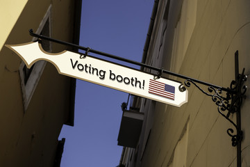 Directional street sign.  Presidential, parliamentary election day concept. Direction to the polling place. Voting booth - United States elections.