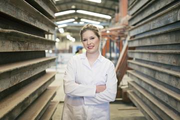 Posing worker woman in factory, Cordoba, Spain